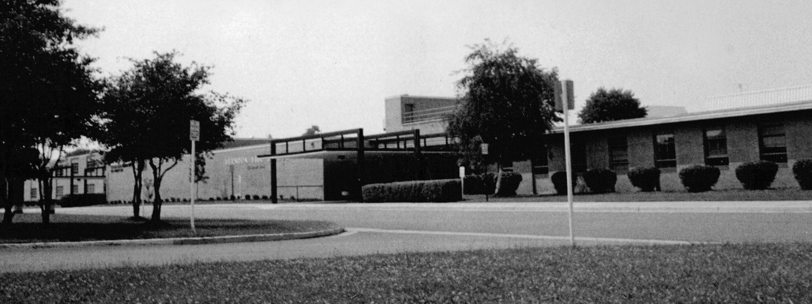 Black and white photograph of the front of Herndon High School's 1967 building. The date the photograph was taken is unknown.